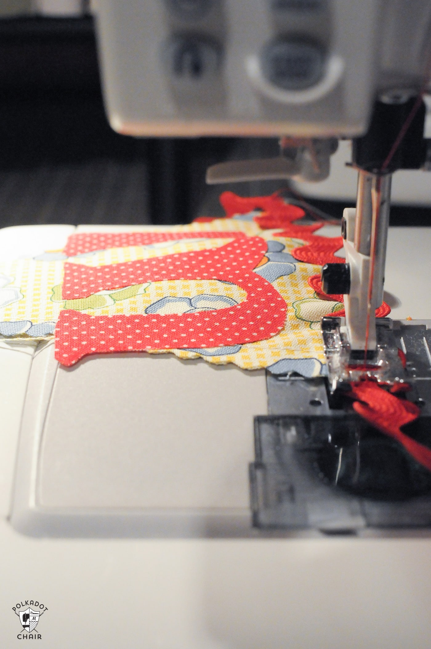 fabric banner being sew on sewing machine