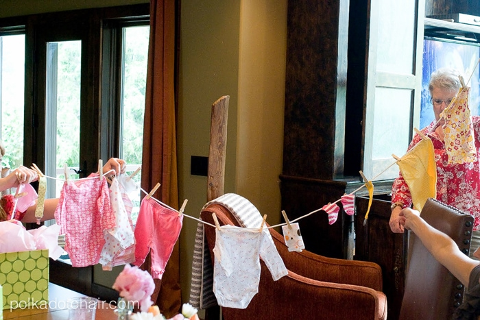 "Adorable Baby Shower Gift idea- give the new mom a ""clothesline"" of baby gifts!"
