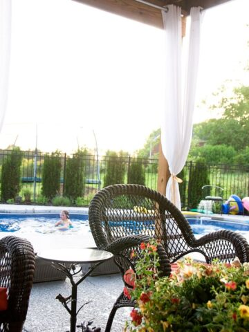 wicker rocking chair and pool