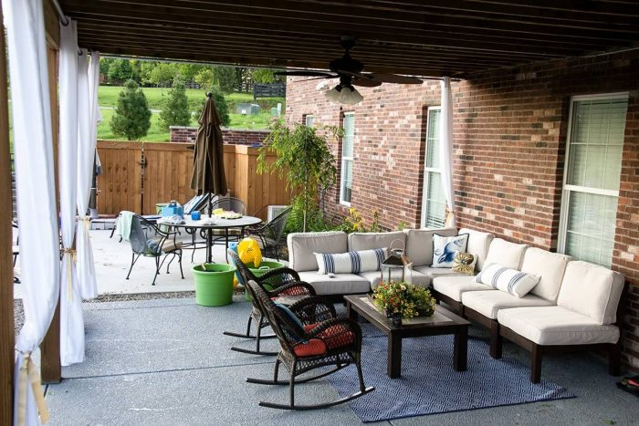 Outdoor patio with curtains and furniture