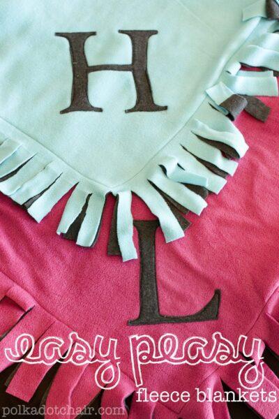 Fleece blankets with monogram on table.