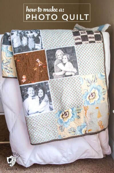 photo quilt hanging on side of bed