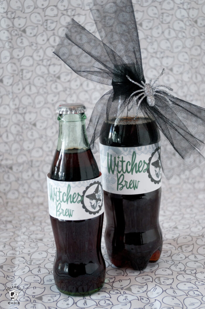 two bottles of diet coke with witches brew labels on white background