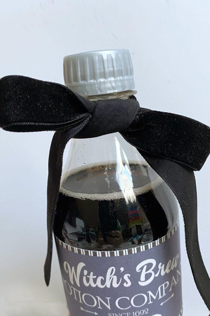 black velvet ribbon on soda bottle