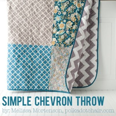 blue and gray quilt hanging on wall