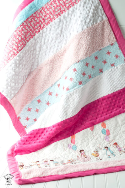 pink and white sensory strip baby quilt