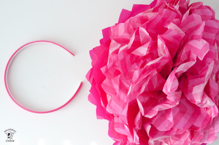 pink flower and headband on white table