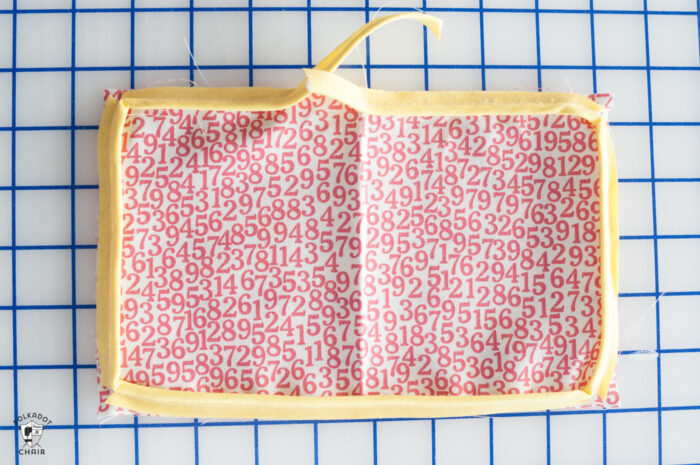red and white fabric on white cutting mat