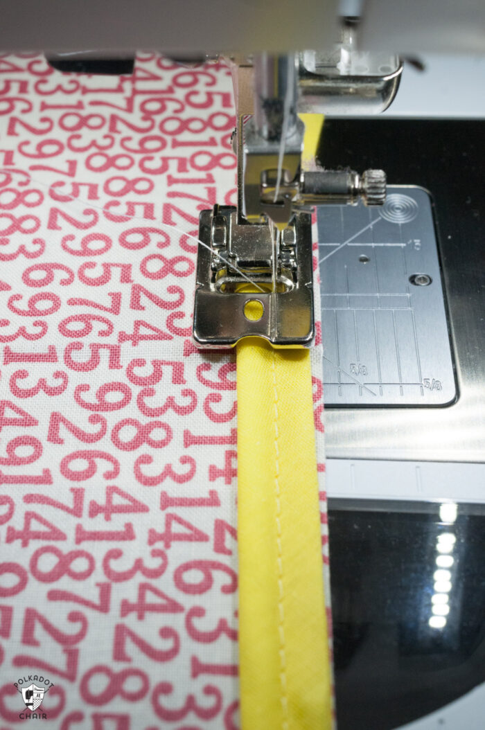 sewn red and white piping under sewing machine foot