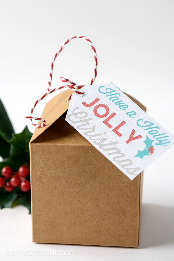 A close up of a box with a holly jolly christmas tag