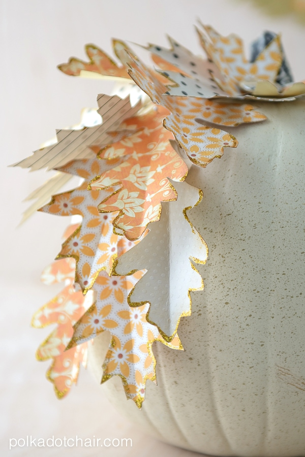 Use die cut paper leaves to decorate a pumpkin for Autumn