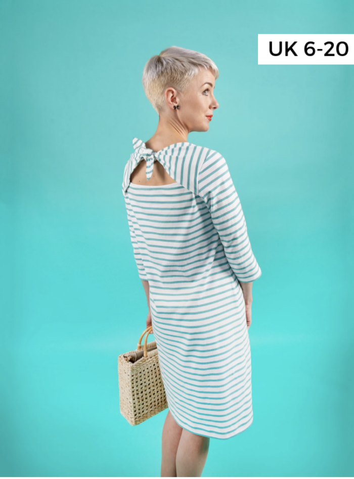 woman in striped dress on blue background