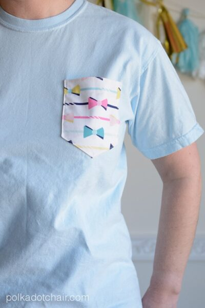 Woman wearing blue tee with white pocket.