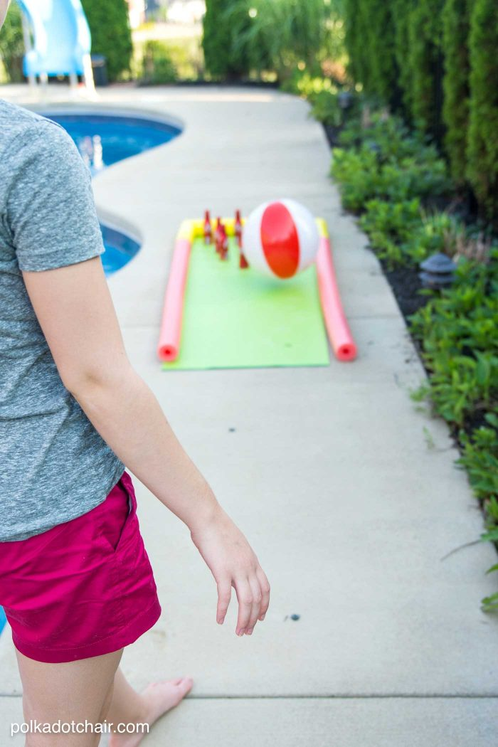 DIY Outdoor Bowling Game, made using Coke bottles, a yoga mat and pool noodles!!