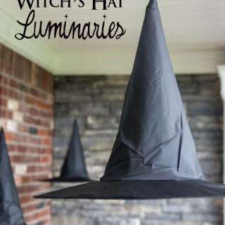 Clever decorating idea for a porch for Halloween, floating Witch's hat luminaries, they even light up at night!