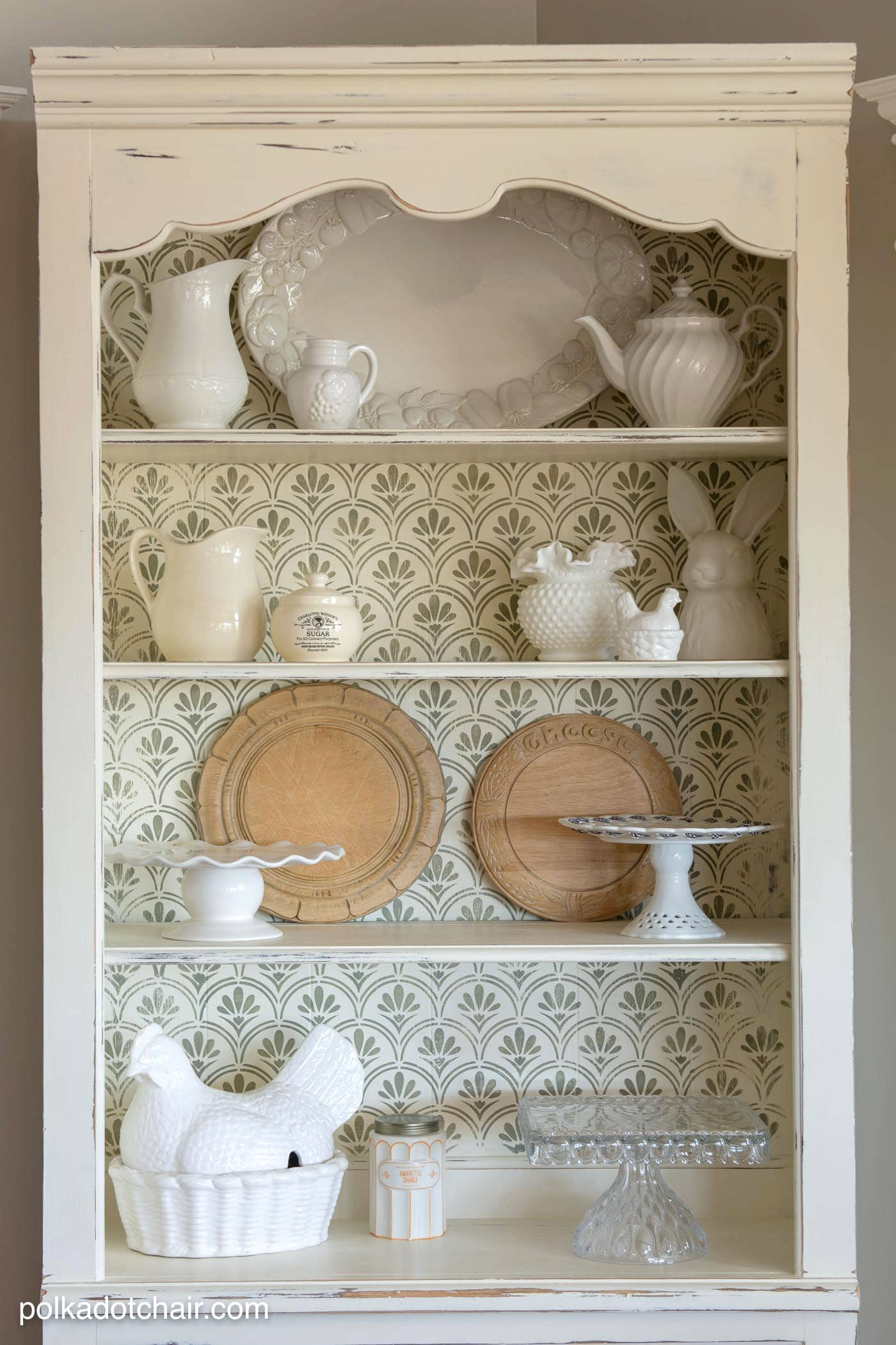 DIY Stenciled Bookcase Project, she painted the bookcase with chalk paint then stenciled a pattern onto the back, looks pretty simple