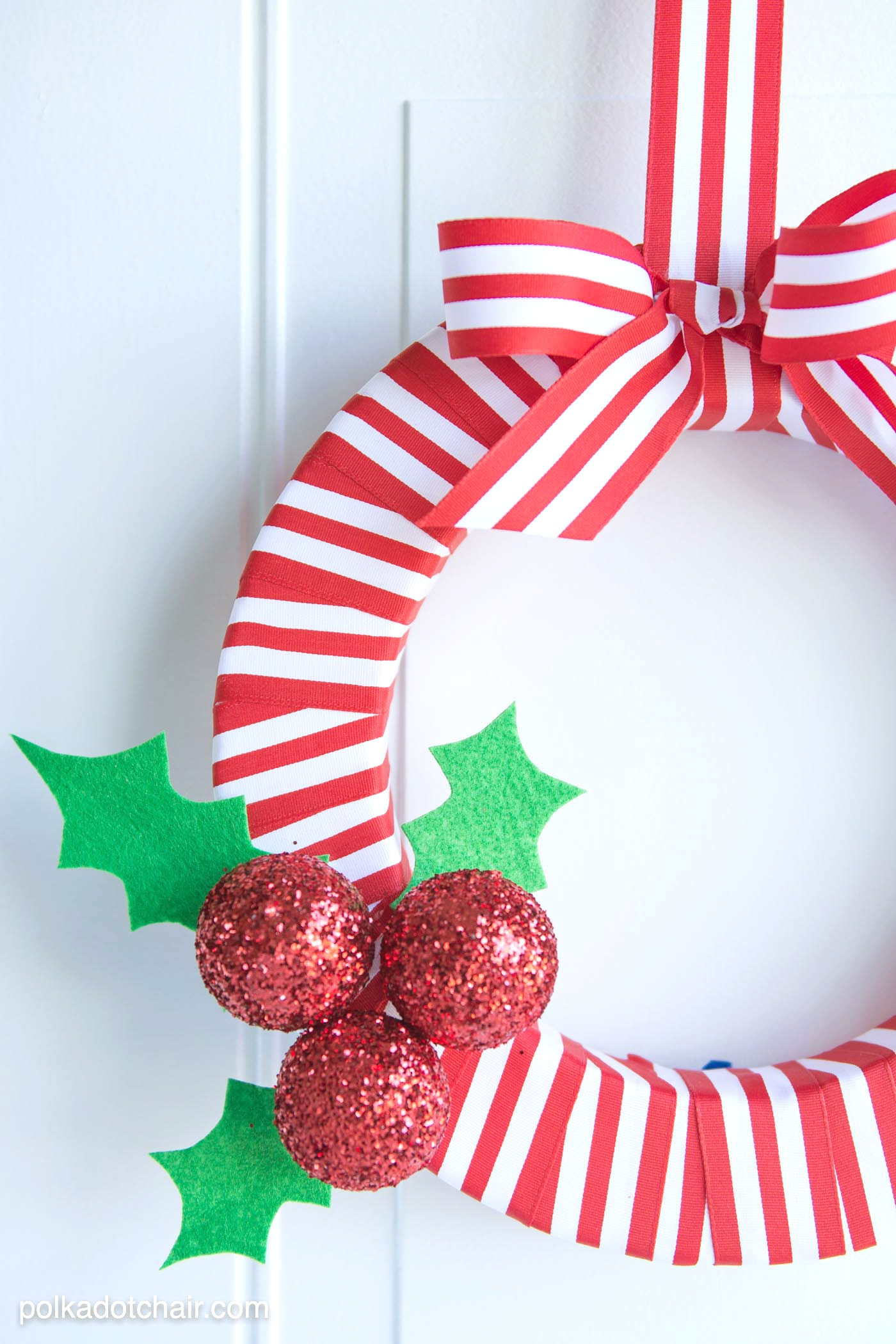 DIY Holly Berry Christmas Wreath made with ribbon, styrofoam balls, felt and glitter