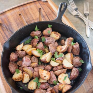 Recipe for red potatoes cooked in a cast iron skillet. Great, easy weeknight dinner side dish recipe!