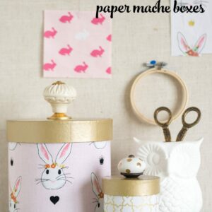 Learn how to cover paper mache boxes with fabric to make these cute DIY storage containers!