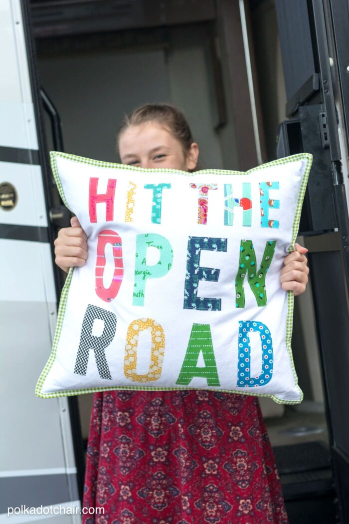 "Free tutorial for a Hit the Open Road pillow, a fun DIY project for an RV or camper. Plus why our family loves to ""Go RV'ing"" - a pillow sewing tutorial (includes the templates for the letters)"