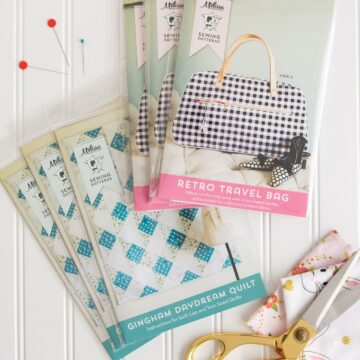 Printed copies of the Retro Travel Bag Sewing Pattern and the Gingham Daydream Quilt Pattern by Melissa Mortenson