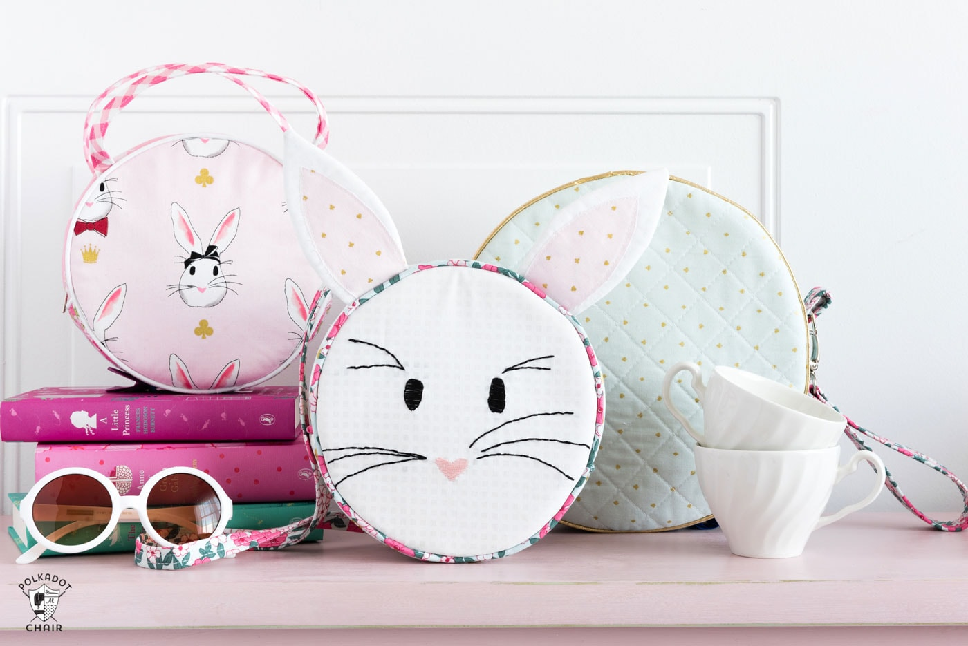 Introducing the Alice Bag Sewing Pattern. A whimsical and versatile purse sewing pattern featuring bunny ears! It can be made in two sizes and features 4 different handle style options including cross body straps!