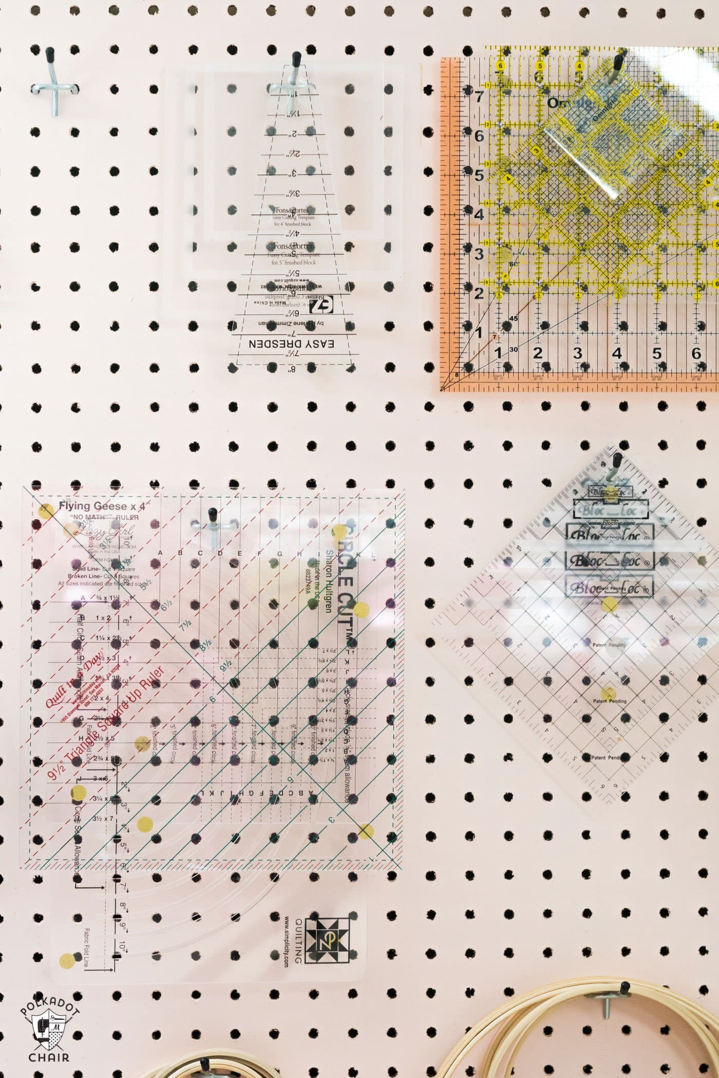 Learn how to make a peg board. Perfect solution for sewing or craft room storage. A great idea to organize your quilt rulers!