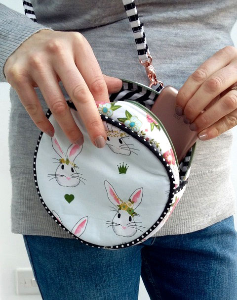 The Alice Bag, a round bag sewing pattern, shown sewn by SewSofia - featuring Wonderland Fabric
