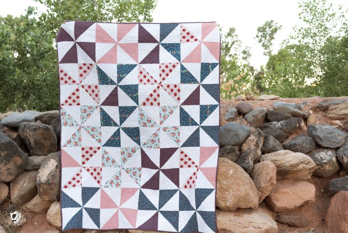 """Summertime Pinwheel Quilt - so easy you can make it with a bunch of layer cakes or 10"""" stackers. A simple summer quilt to make"""