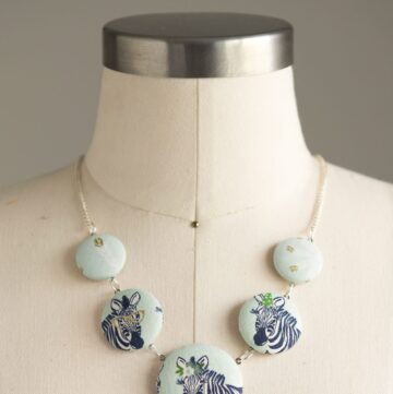 Make a cute statement necklace with this fabric covered button necklace tutorial by Melissa Mortenson of polkadotchair.com