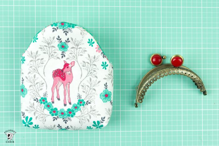 constructed purse and metal frame on cutting mat