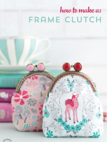 Frame Clutch on table with books