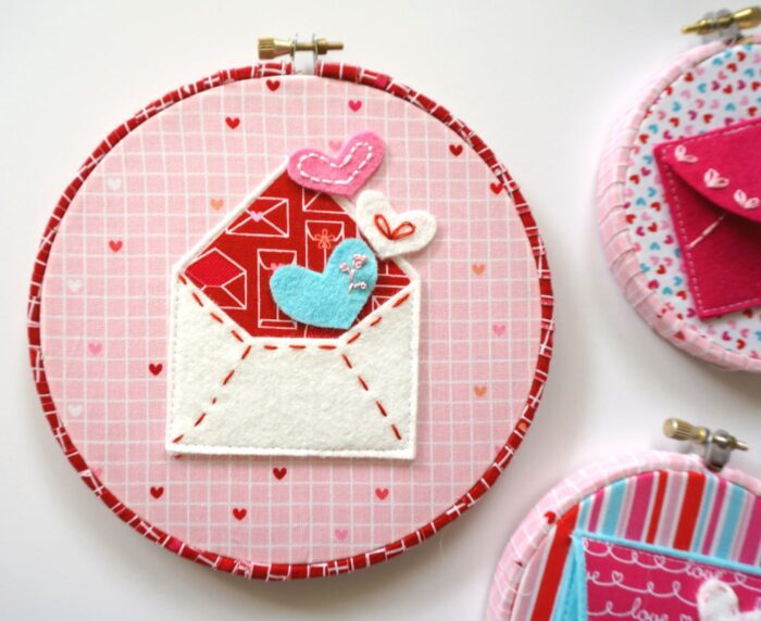 """A free pattern for """"Love Notes"""" a Valentine's Day Craft idea. A felt envelope tutorial - with hand embroidery and felt applique #ValentinesDay #ValentinesDayCraft #FeltEnvelope #FeltCrafts #FeltProject #EmbroideryHoopArt"""