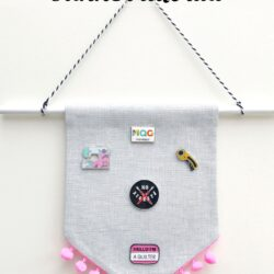 A great enamel pin display idea! Create a banner for your favorite pins with this DIY Enamel Pin Banner Tutorial. #enamelpins #sewingtutorial #pindisplayideas #bannertutorials #canvasbannertutorial
