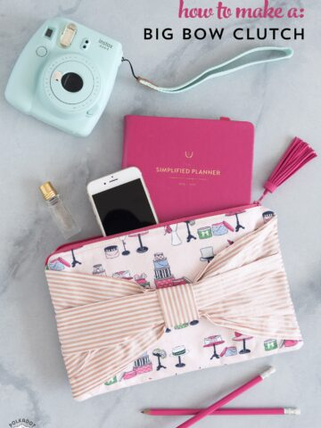 Big Bow Clutch; A DIY clutch purse pattern and free sewing tutorial. How to make an easy fabric clutch with a bow on the front. Fun sewing gift ideas.