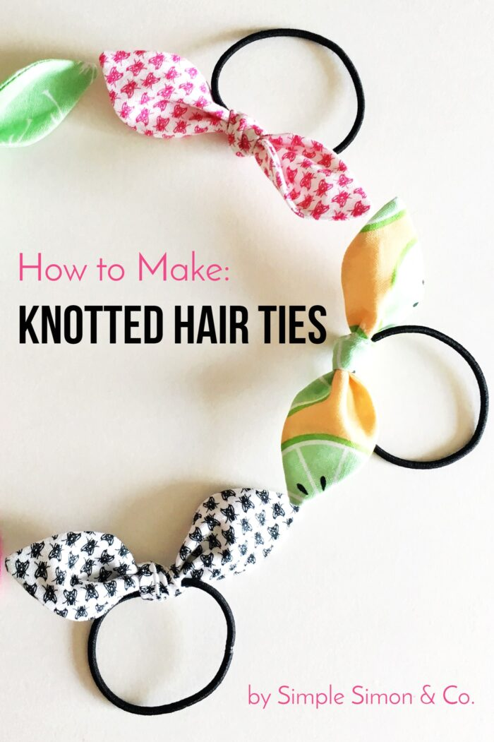 knotted hair ties in various colors on white table