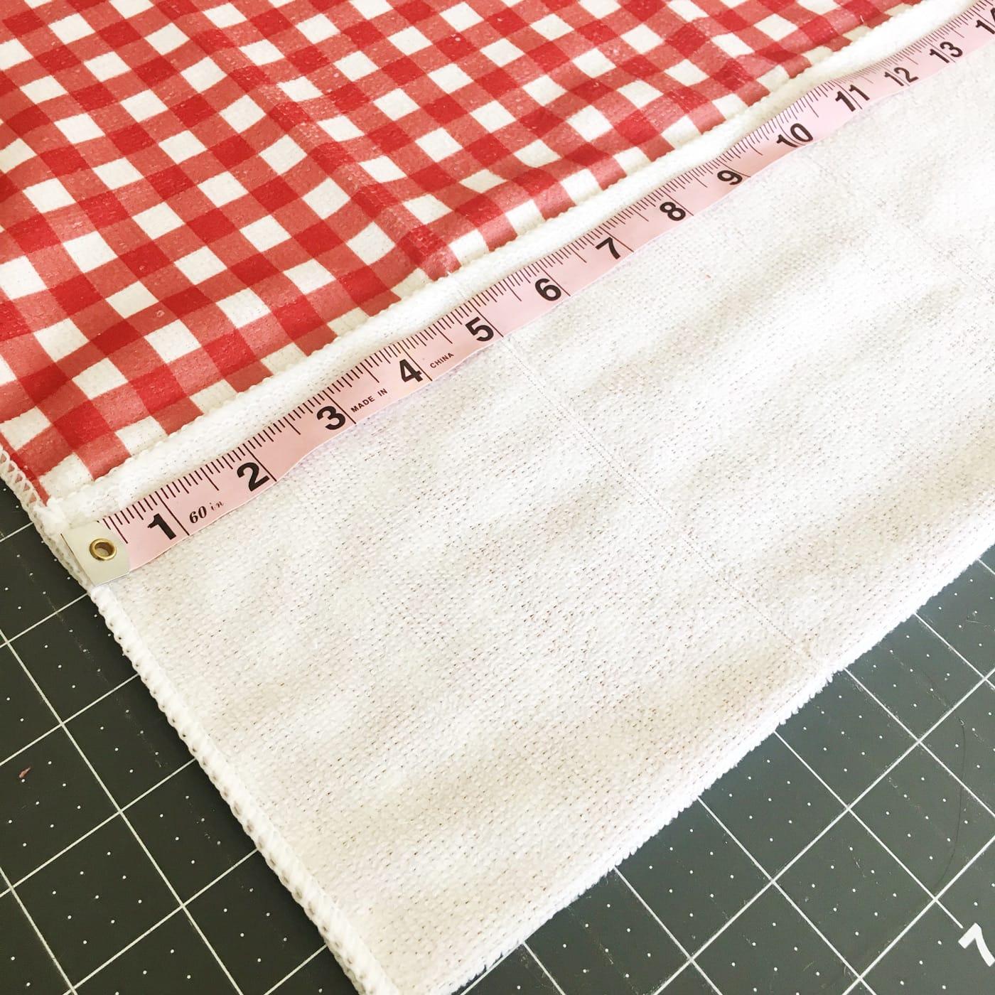 sizing the dishtowel to make the bbq apron