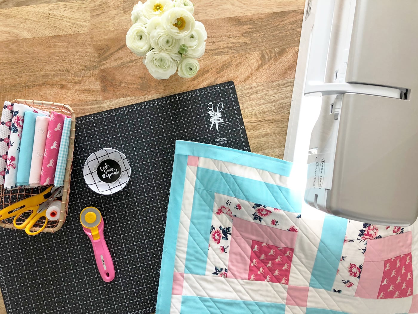 mini quilt under sewing machine