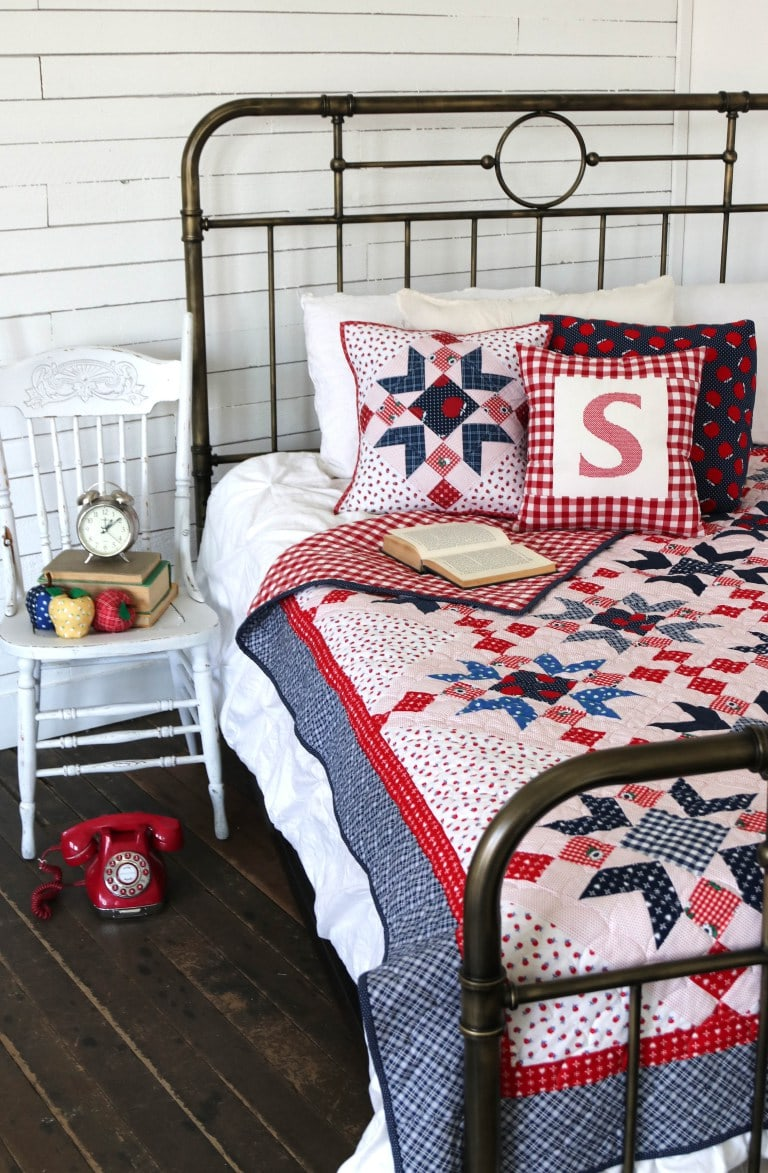 red white and blue summer quilt on a bed