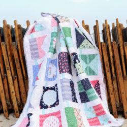 seas the day nautical quilt on wood beach chairs on beach