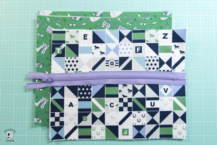fabric and zippers on cutting mat