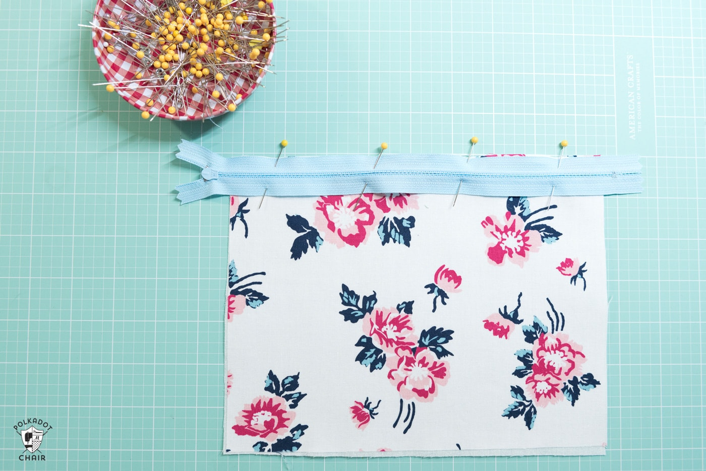 zipper pinned to fabric piece