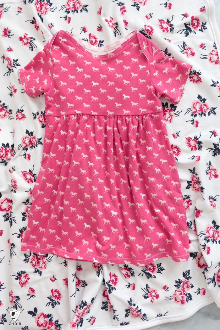 baby dress and floral baby blanket