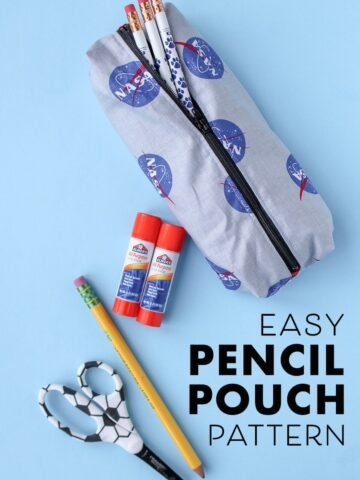 pencil pouch with glue stick and pencil on blue background
