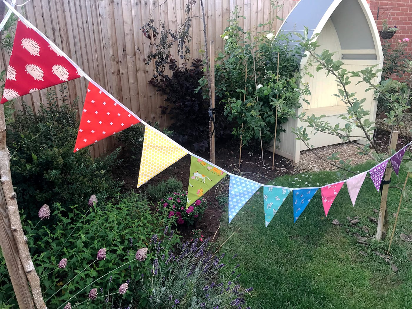 rainbow flag bunting on white tabletop