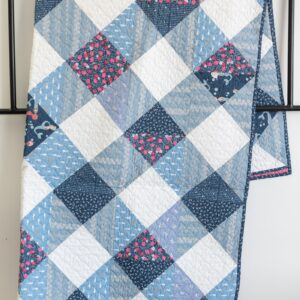 Gingham quilt pattern on white wall