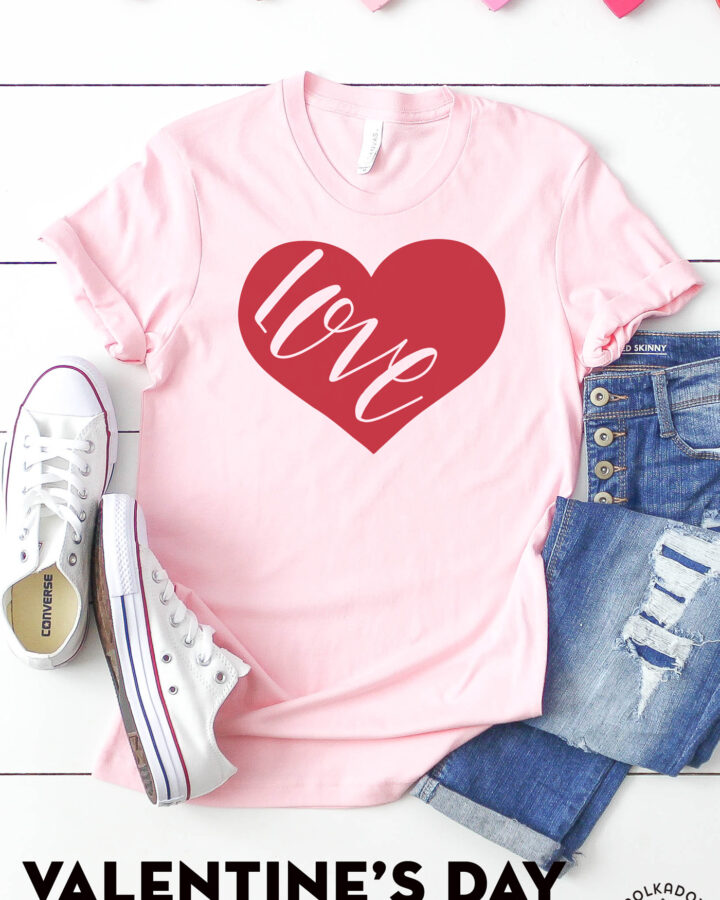 Love t-shirt on white table