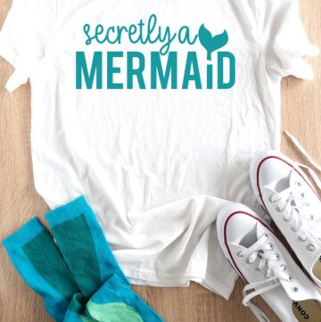 secretly a mermaid shirt on table