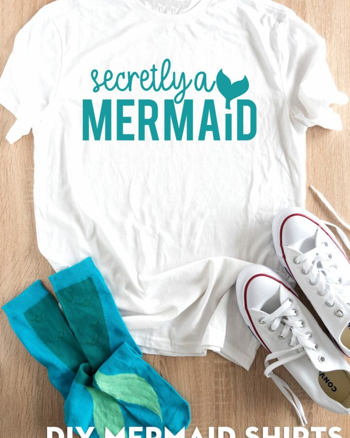 secretly a mermaid shirt on table