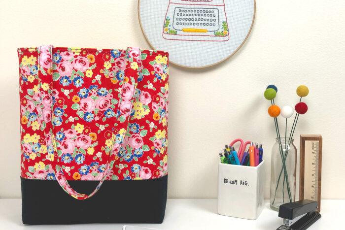 sewn tote bag on white table
